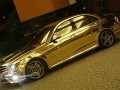 Mercedes Benz C63 AMG de oro